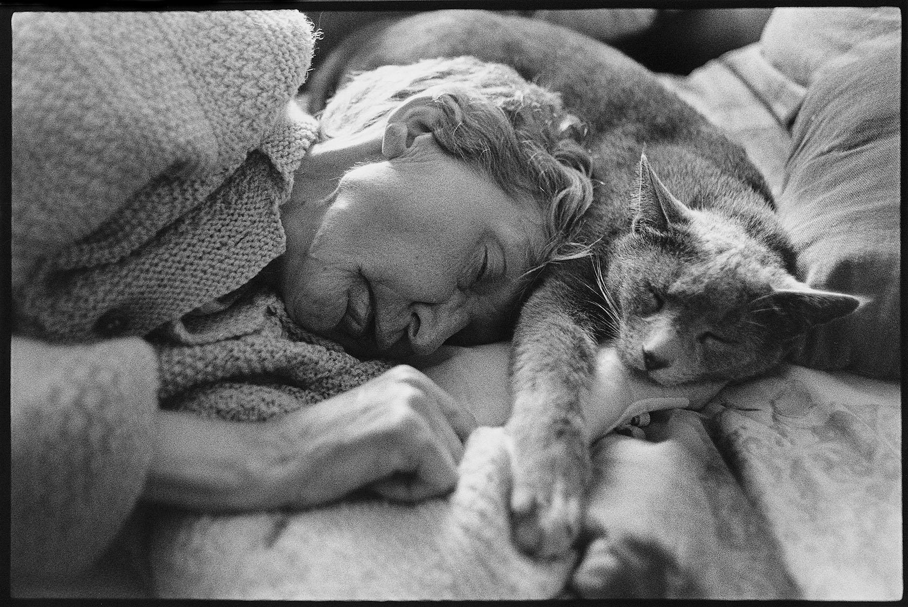 Grandmother sleeping with my cat.